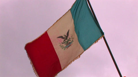 A flag of Mexico flies in the wind at a reenactmen Footage