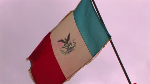 A flag of Mexico flies in the wind at a reenactmen Stock Video Footage
