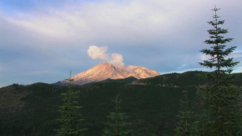 The collapsed caldera of Mount St. Helen's smokes Stock Video Footage