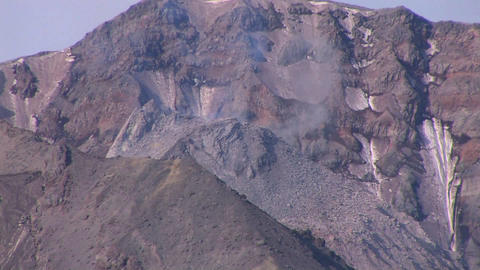 Smoke rises from a rocky mountain at Mt. St. Helen Stock Video Footage