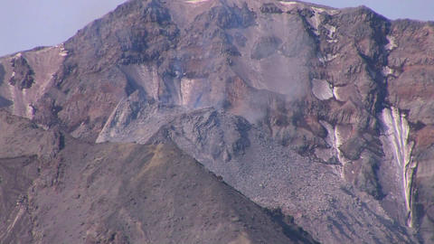 Smoke rises from a rocky mountain at Mt. St. Helen Live Action