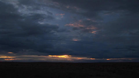 A time lapse of dark clouds at sunset Stock Video Footage