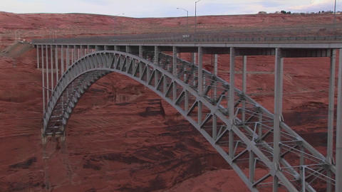 A metal bridge connects to a red and rocky mountai Stock Video Footage