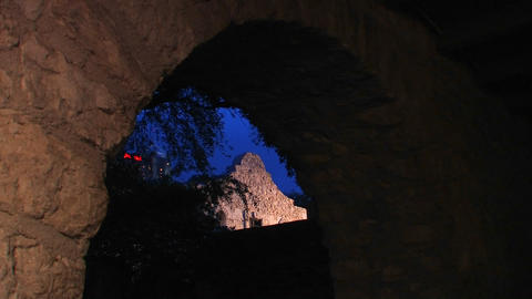 A stone wall is seen through a brick archway in Sa Stock Video Footage