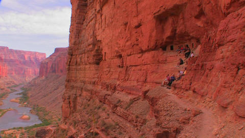 A beautiful shot of tourists on a trail along the  Footage