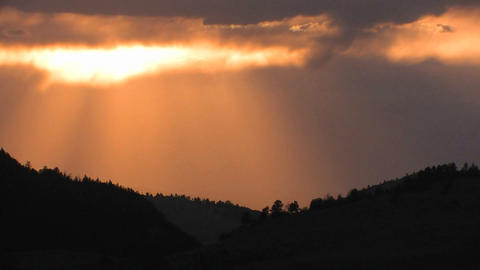 The suns rays shine through clouds in this heavenl Stock Video Footage