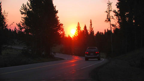 Sunrise Over A Road With A Subaru Passing stock footage