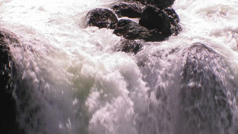 A medium sized waterfall flows Footage