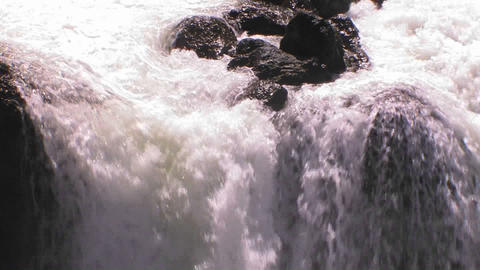 A medium sized waterfall flows Stock Video Footage