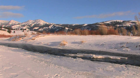 A cold river flows through a snowy landscape Stock Video Footage