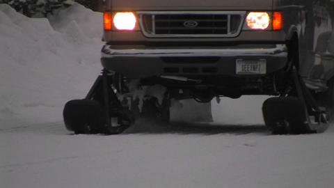 A snowplow truck moves along a snowy road Stock Video Footage