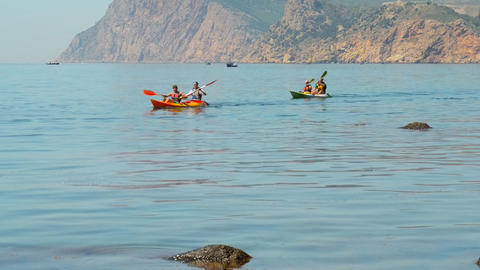 traveler kayaking in the Black sea from backward v Footage