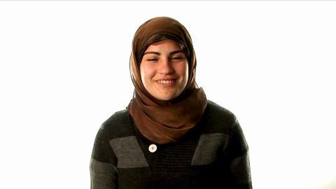 A woman wears a headscarf Footage