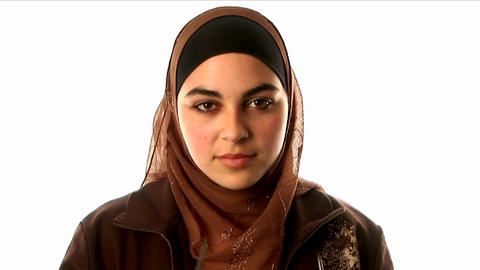 A woman wearing an underscarf, headscarf and sweat Footage