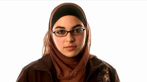 A woman wearing an underscarf, headscarf and sweat Stock Video Footage