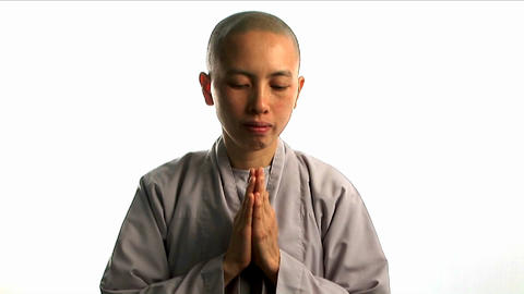 A young Buddhist monk prays Stock Video Footage