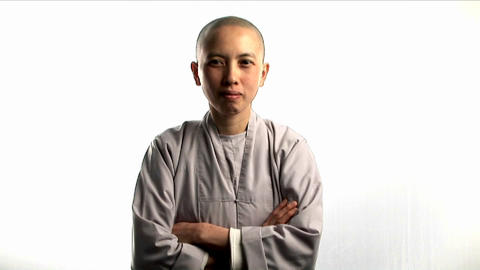 A young Buddhist monk laughs Stock Video Footage