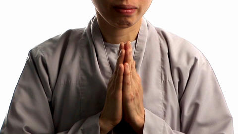A young Buddhist monk prays Footage