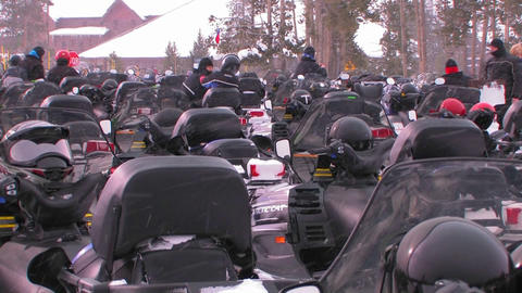 Many snowmobiles are lined up in a snowmobile park Footage