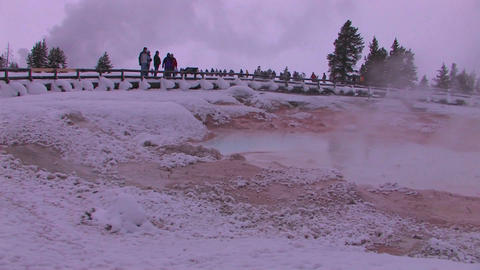 Tourist gather around a geothermal area in Yellows Stock Video Footage