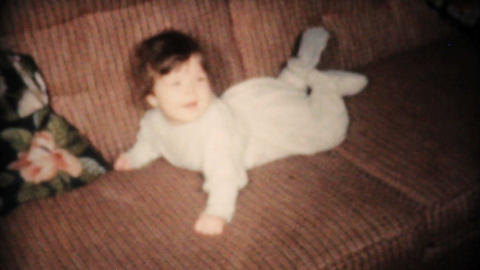 Cute Baby Laying On Sofa 1961 Vintage 8mm film Stock Video Footage