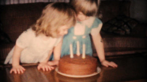 Girl Blows Out Candles On Third Birthday Cake 1961 Stock Video Footage