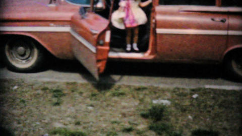 Young Girls Getting Out Of Car With Easter Treats Stock Video Footage