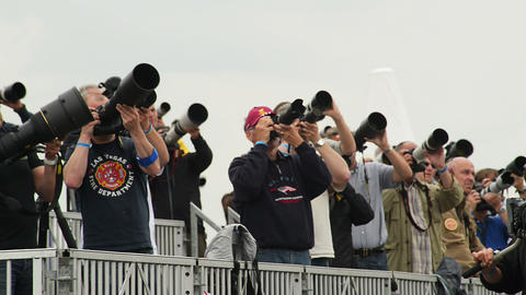 10967 Reporter Spotter with big camera lenses Stock Video Footage