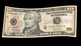 US 10 Dollar Bill Blowing In The Wind stock footage