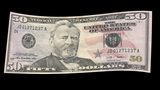US 50 Dollar Bill Blowing In The Wind stock footage
