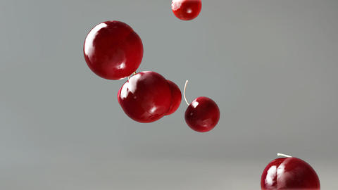 cherry falling down grey Stock Video Footage