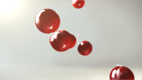 cherry falling down with glow flare Stock Video Footage