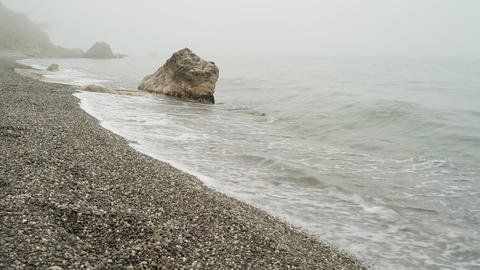 Hidden beach in the mountains in the fog Footage