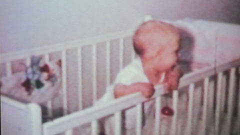 Cute Baby Boy In His Crib 1964 Vintage 8mm film Stock Video Footage