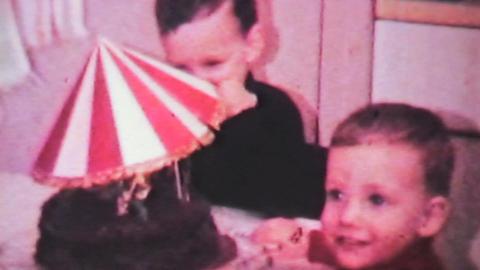 Boy Celebrates Birthday With Cake-1966 Vintage 8mm Stock Video Footage