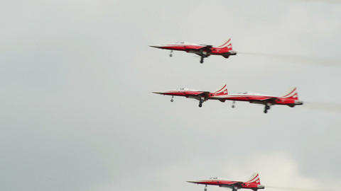Patrouille Suiss soloist flies through formation 1 Stock Video Footage