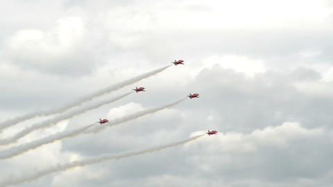 Red Arrows soloists flight encounter 10993 Stock Video Footage