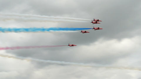 Red Arrows soloists flight encounter 10993 Stock Video Footage