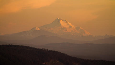 Sunset color on a Snow Mountain Stock Video Footage