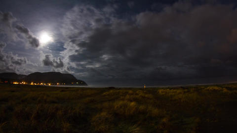 Extreme Wide Shot of Night Clouds at Seaside Footage