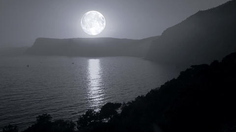The sun turns into the moon. The sea and the mount Stock Video Footage