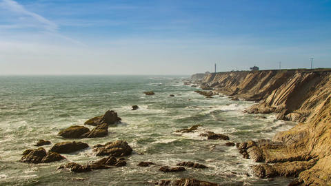 Clouds and Waves by a Lighthouse Stock Video Footage