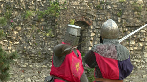 medieval fighting slow motion red blu 01 Stock Video Footage