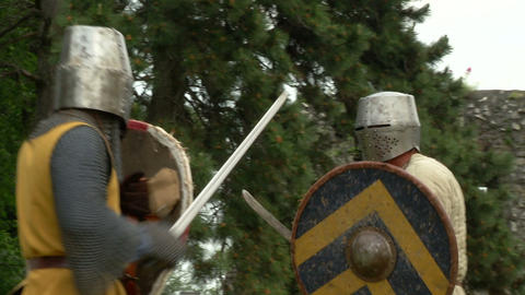 medieval fighting slow motion yellow brown 01 Stock Video Footage