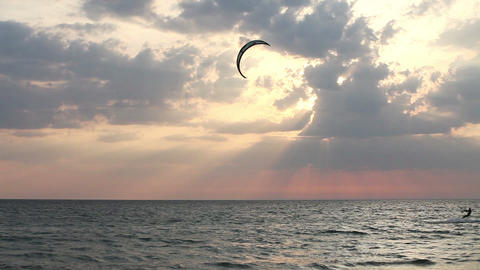 Kite surfer sailing on the sea at sunset Stock Video Footage