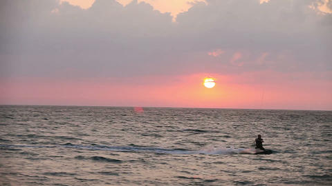 Kite surfer sailing on the sea at sunset Footage