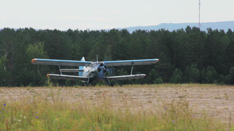 Antonov An-2 russian retro biplane aircraft taxiin Stock Video Footage