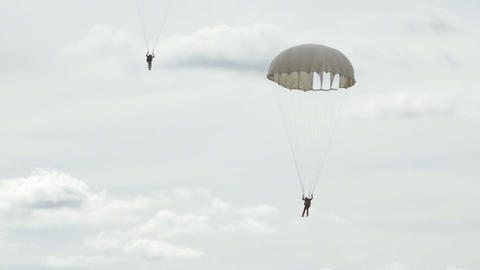 Extreme ultra low altitude parachute jump Stock Video Footage