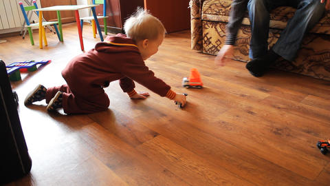 kid playing with toy cars Stock Video Footage