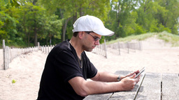 Man at Beach with iPad Stock Video Footage
